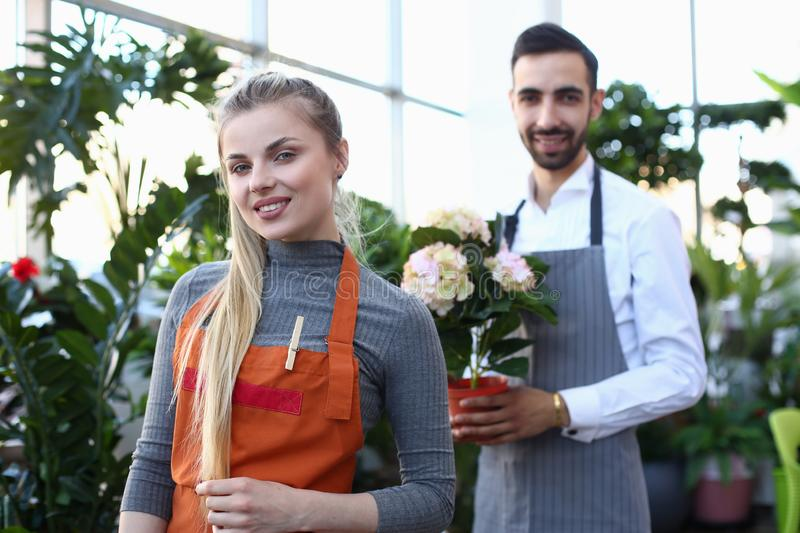 Beautiful Blonde Woman Florist and Man with Flower stock images
