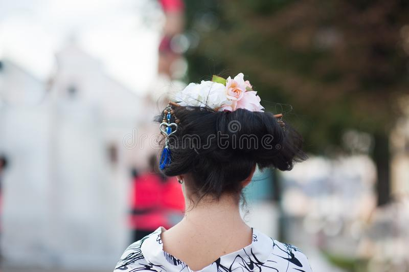 Beautiful blonde woman with flower wreath on her head. Beautiful girl with flowers hairstyle. Fashion photo royalty free stock images