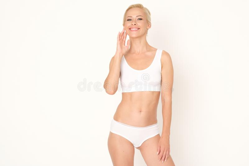 Beautiful blonde woman with a healthy and fresh complexion. Perfect treatment for glowing your skin. stock photo