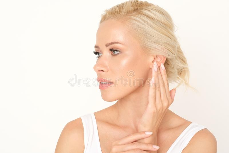 Beautiful blonde woman with a healthy and fresh complexion. Perfect treatment for glowing your skin. stock photos