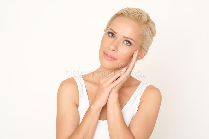 Beautiful blonde woman with a healthy and fresh complexion. Perfect treatment for glowing your skin. royalty free stock images
