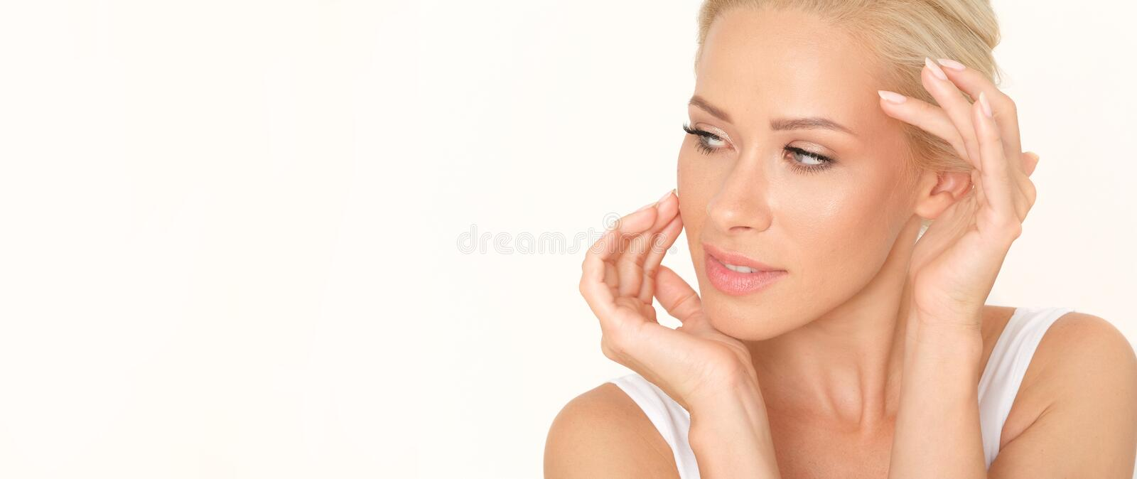 Beautiful blonde woman with a healthy and fresh complexion. Perfect treatment for glowing your skin. stock image
