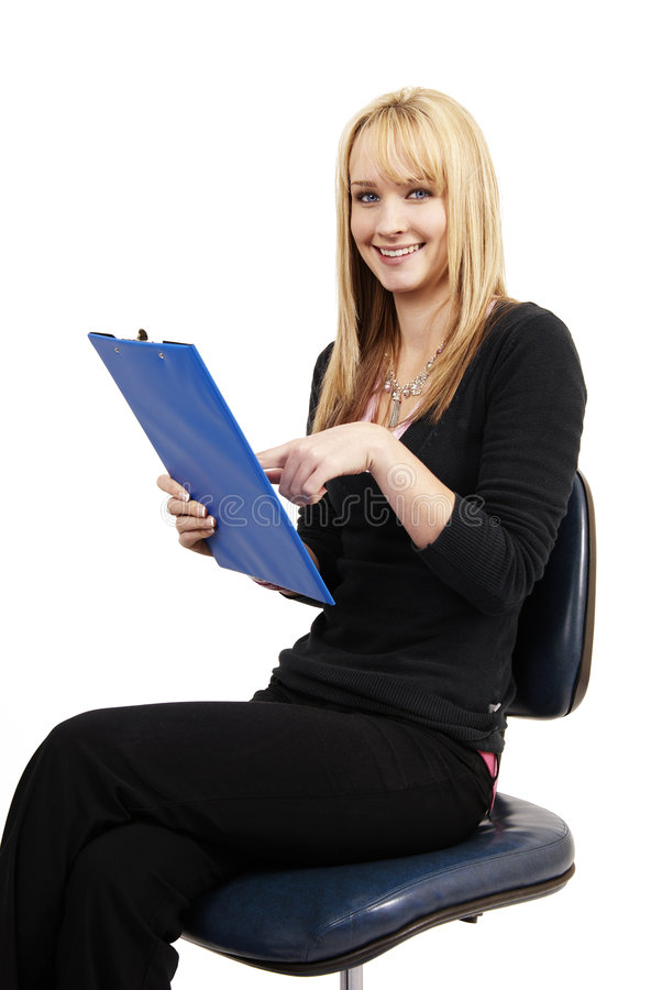 Beautiful blonde woman holding her clipboard stock photography