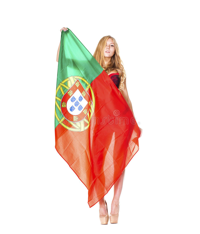 Beautiful blonde woman holding a large Portuguese flag royalty free stock photography