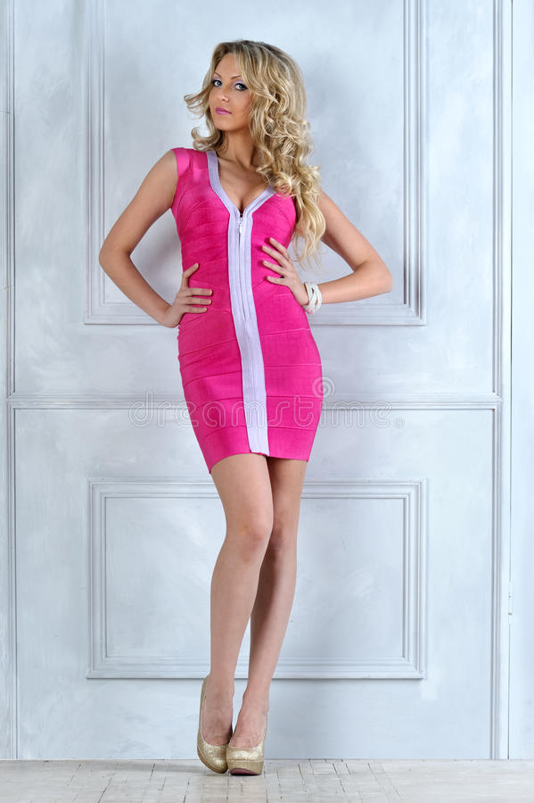 Free Beautiful Blonde Woman In A Pink Dress. Royalty Free Stock Photos - 26404088