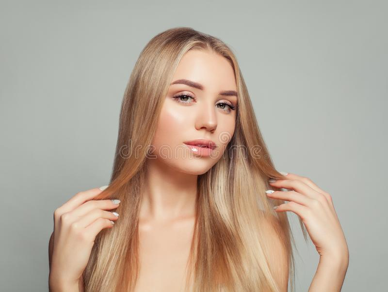 Beautiful blonde woman with long healthy blonde hair royalty free stock image