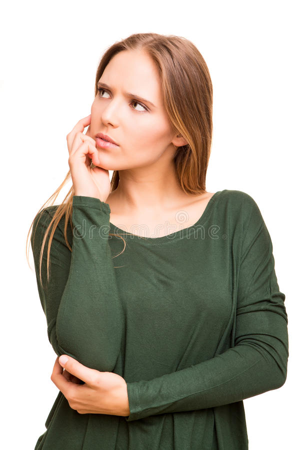 Beautiful blonde woman lost in her thoughts stock photo