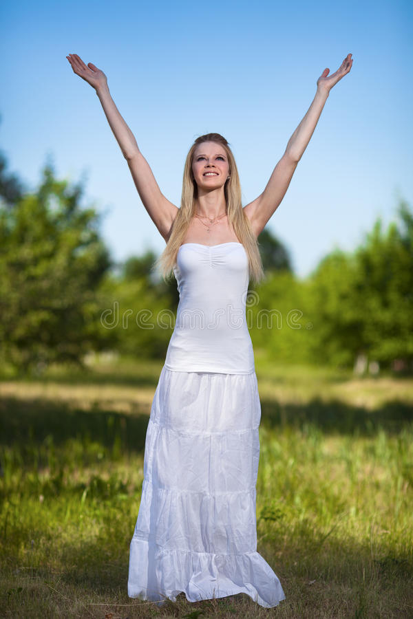 Beautiful blonde woman in park royalty free stock photo