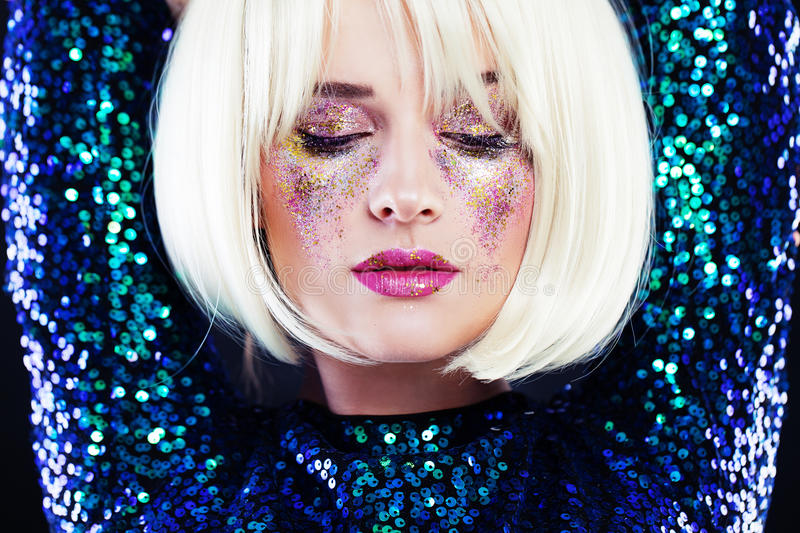 Beautiful Blonde Woman with Party Glitters Makeup stock photography