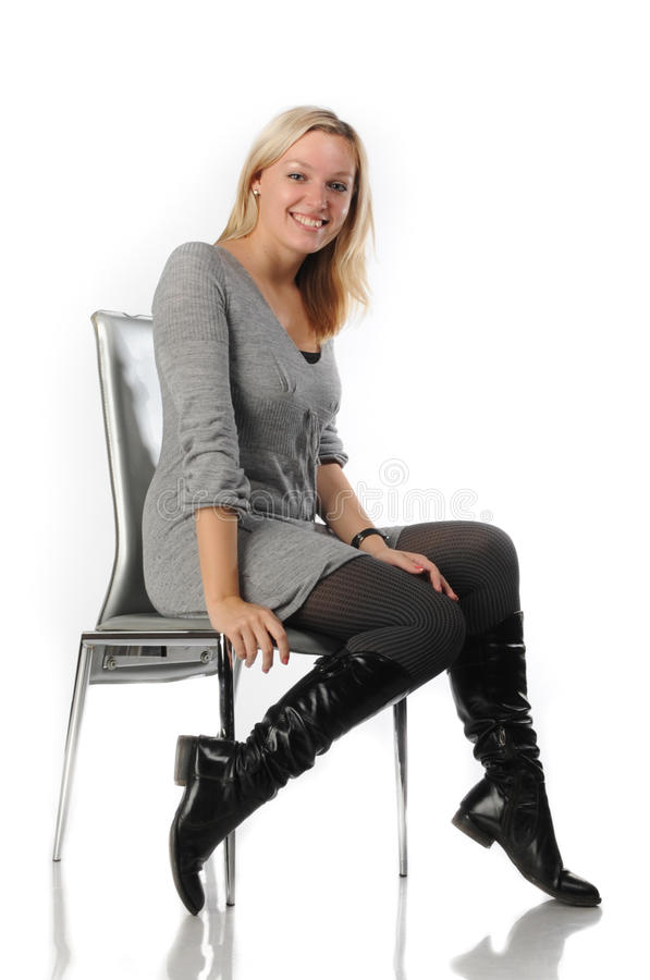 Free Beautiful Blonde Woman Sit On Chair Royalty Free Stock Photos - 18201498