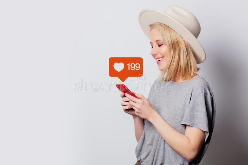 Beautiful blonde woman using mobile phone on white background stock image