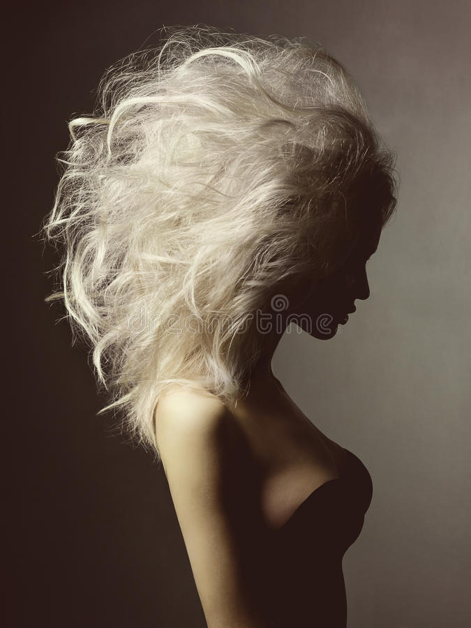 Beautiful blonde woman with volume hairstyle royalty free stock image