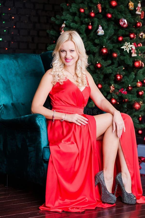Beautiful blonde woman wearing red dress royalty free stock image