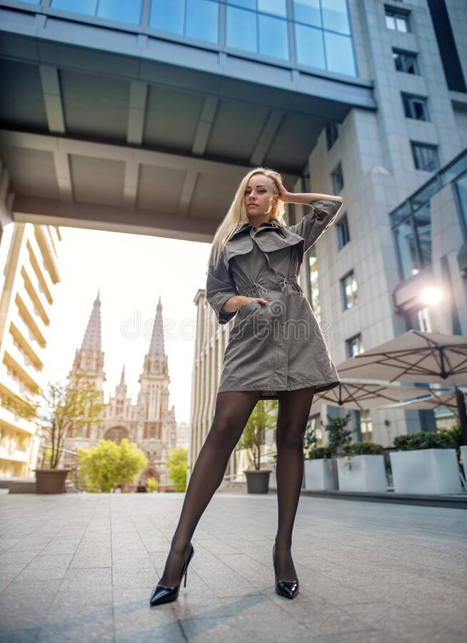 Free Beautiful Blonde Woman With Perfect Legs In Pantyhose And Shoes With High Heels Posing On The City Square Royalty Free Stock Photo - 220061625