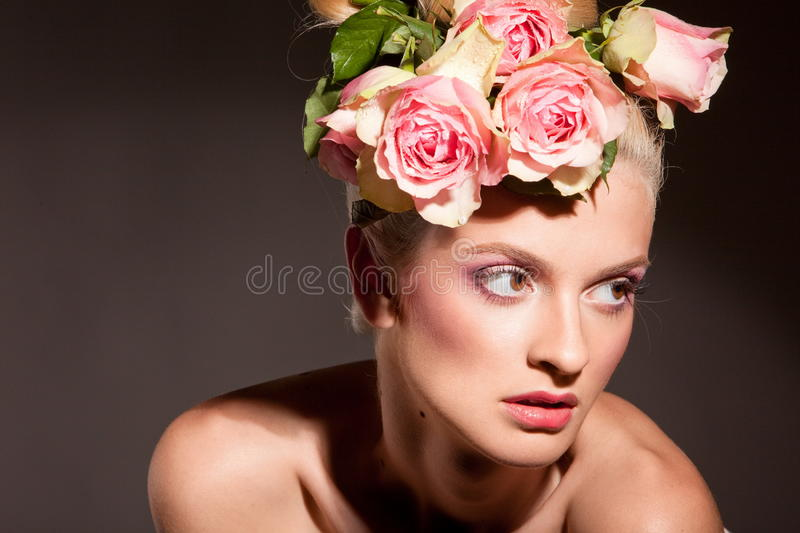 Beautiful blonde with a wreath of flowers stock photo