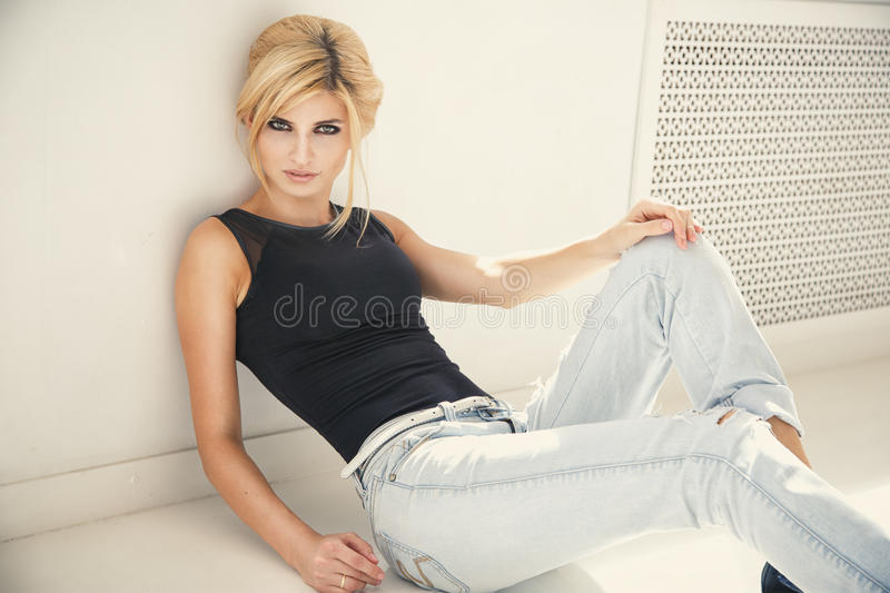 Beautiful blonde young woman in casual style. Fashion model. Beauty portrait stock photos