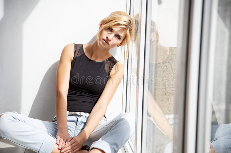 Beautiful blonde young woman in casual style. Fashion model royalty free stock photo