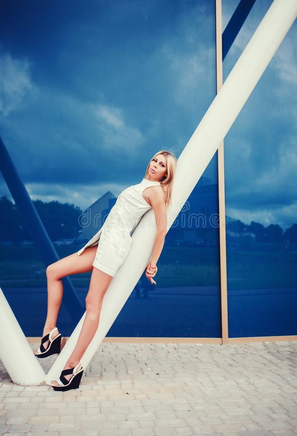 Beautiful blonde young woman in nice clothes stock image