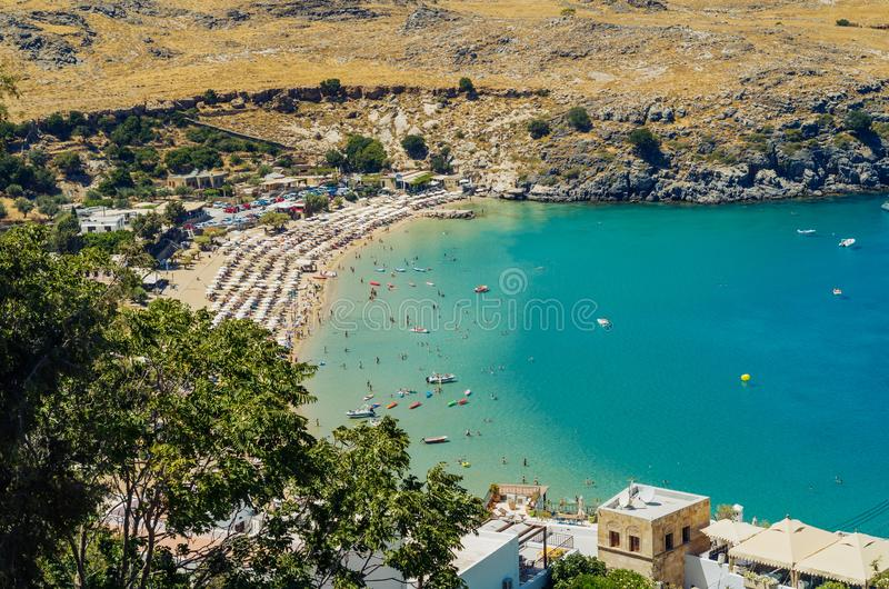 A beautiful blue bay and public beach in Lindos, Rhodes, Greece stock images