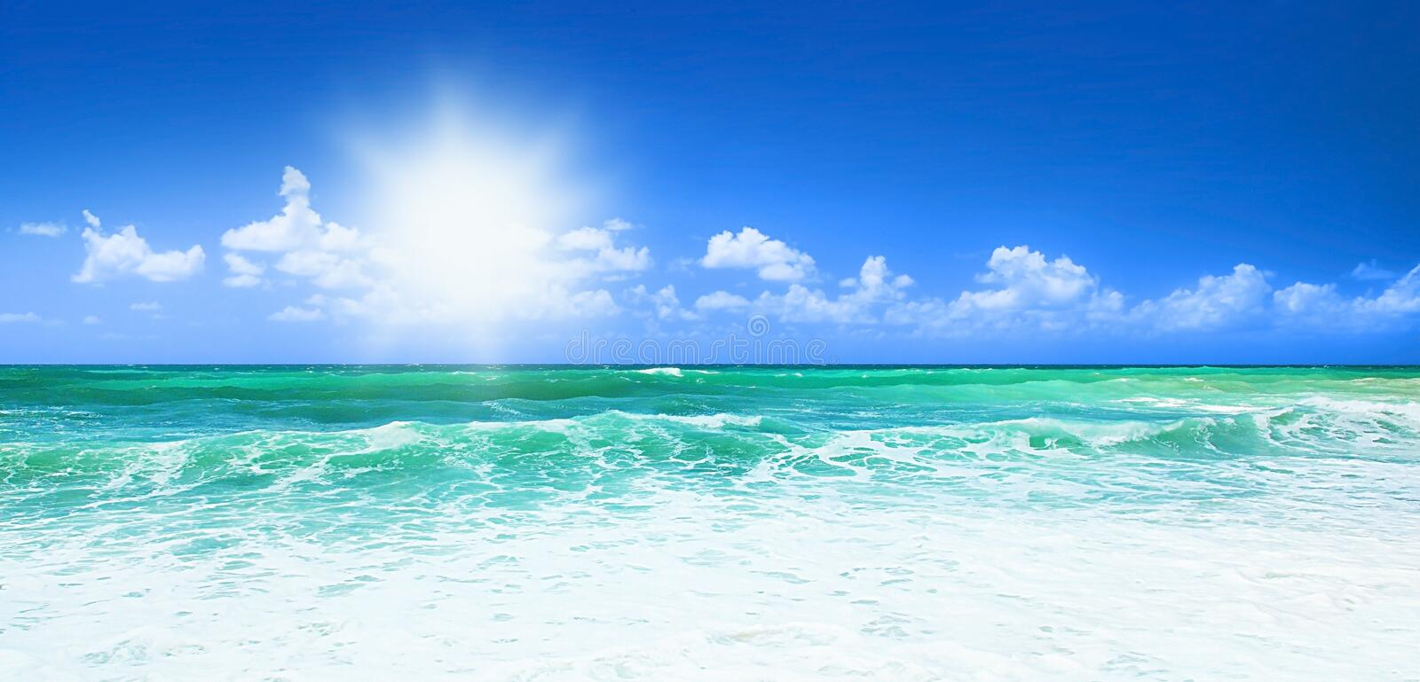 Beautiful blue beach. Panoramic sea view, with clean water & blue sky, concept of vacation & peace stock photography
