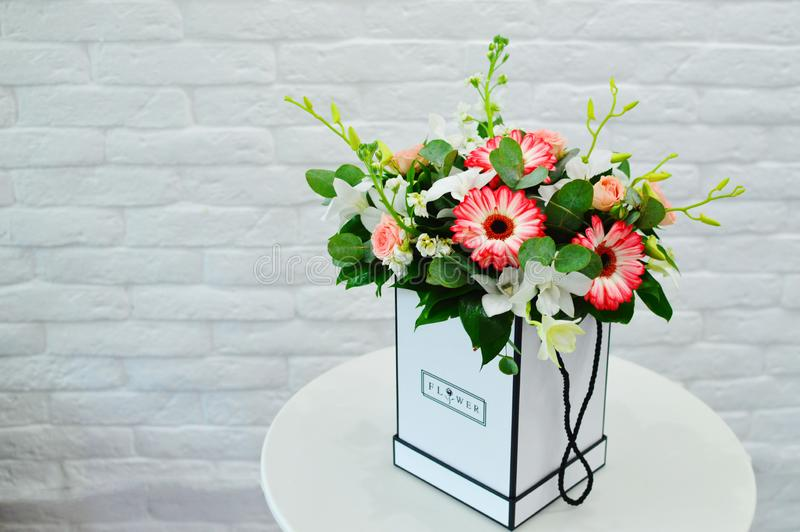 Beautiful blue bouquet of flowers in a white box royalty free stock image