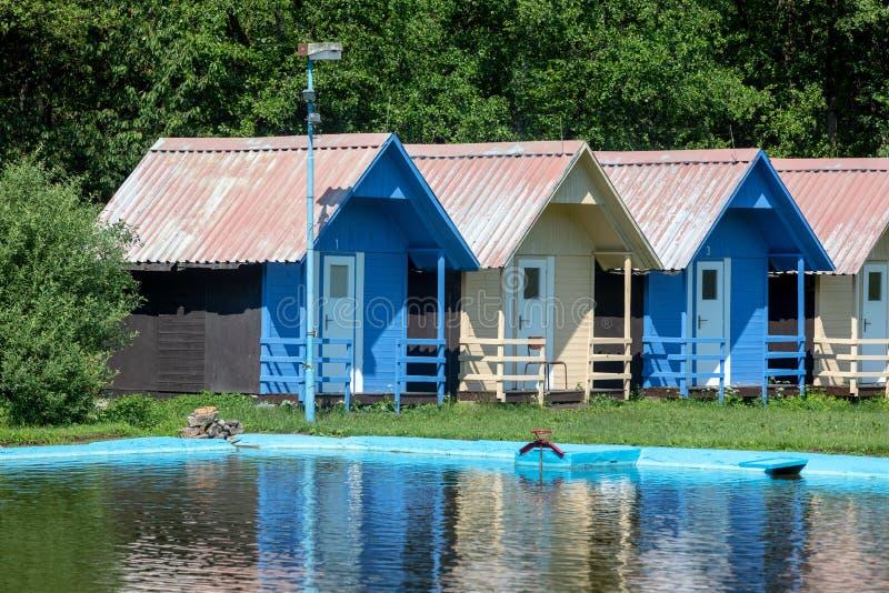 Children`s chalets camp in summer. Beautiful blue chalets in a summer camp for children stock photos