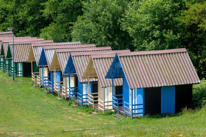 Children`s chalets camp in summer. Beautiful blue chalets in a summer camp for children royalty free stock photo