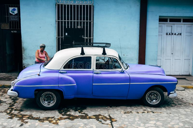 A beautiful classic car in Trinidad, Cuba. A beautiful blue classic car with roof rack parked in Trinidad, Cuba stock photos