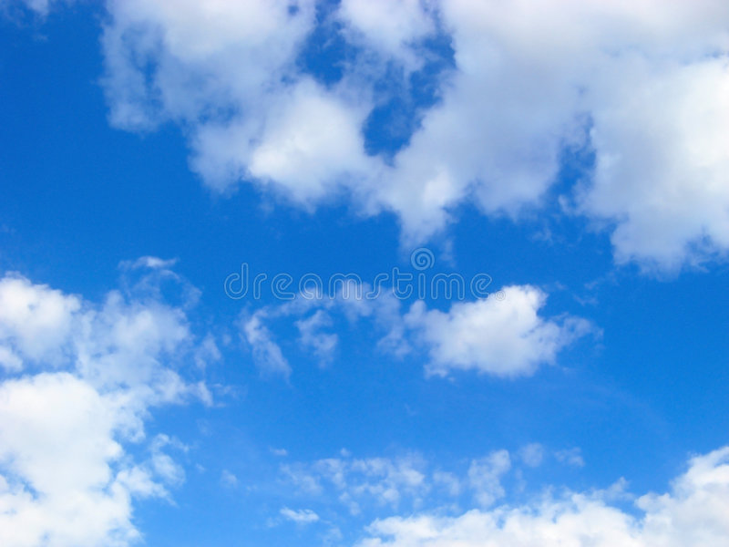 Beautiful blue cloudy sky. At bright sunny day stock images