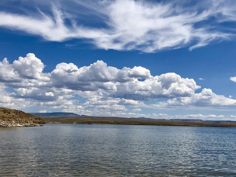 Beautiful blue cloudy sky over the lake. At Flaming Gorge, Wyoming stock images