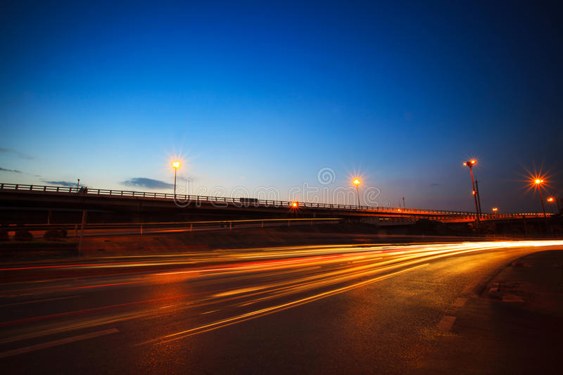 beautiful blue dusky sky peak of twilight time and light painting on asphalt road by vehicle moving use for land transport and ur royalty free stock images