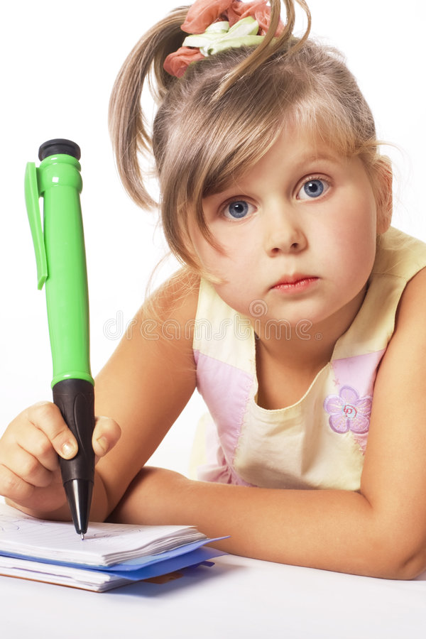 Beautiful blue-eyed girl. Blue-eyed little girl with big green pen isolated on white royalty free stock photos