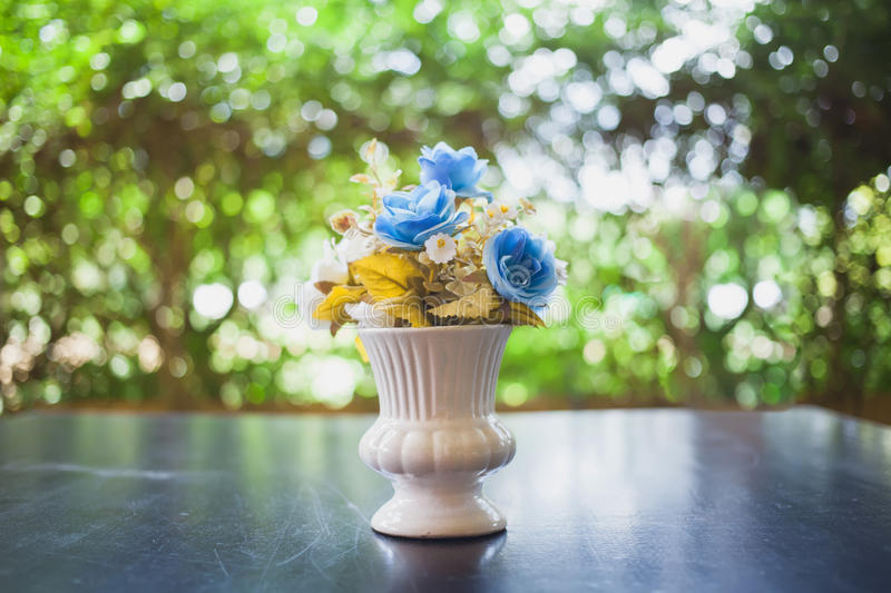 Beautiful blue flowers in pot on nature background. Summertime, Beautiful blue flowers in pot on nature background royalty free stock photo