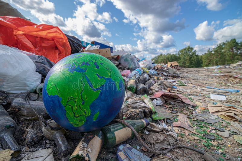 Landscape planet earth in landfill. Concept of environment pollution by garbage. stock photo