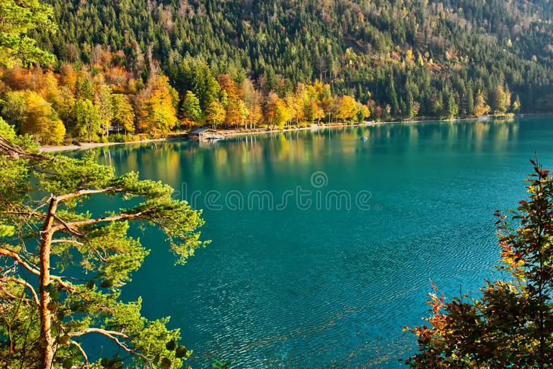 Beautiful mountain lake on a warm fall season day. Beautiful blue mountain lake on a warm fall season day stock photography