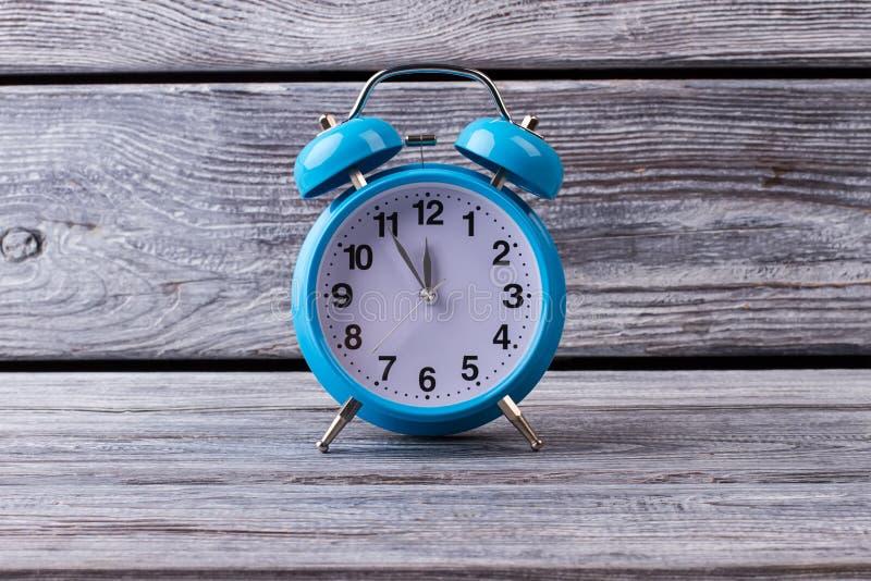 Beautiful blue retro alarm clock. stock image