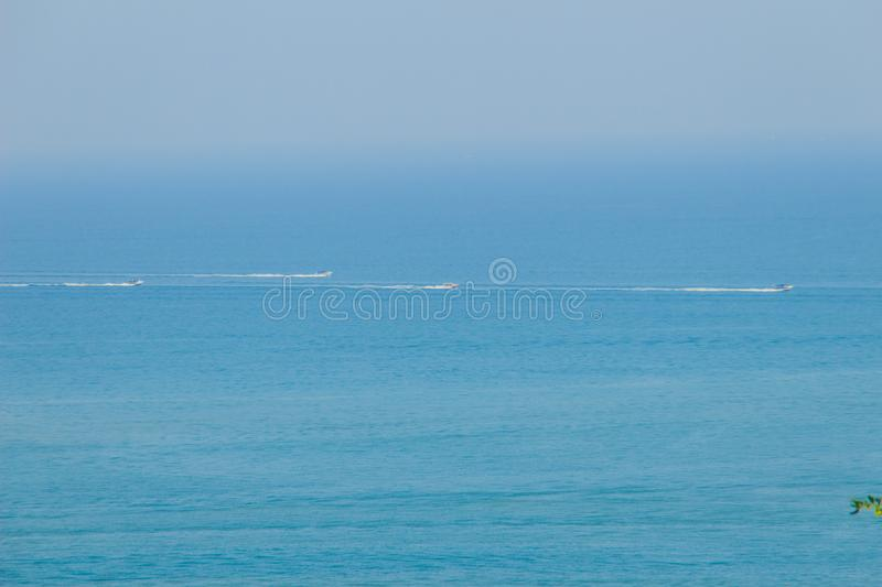 Beautiful blue sea view and tourist water activities such as boat racing, yacht cruising and jet skiing on Koh Sire beach. This pi. Cture took from top of Wat royalty free stock photos