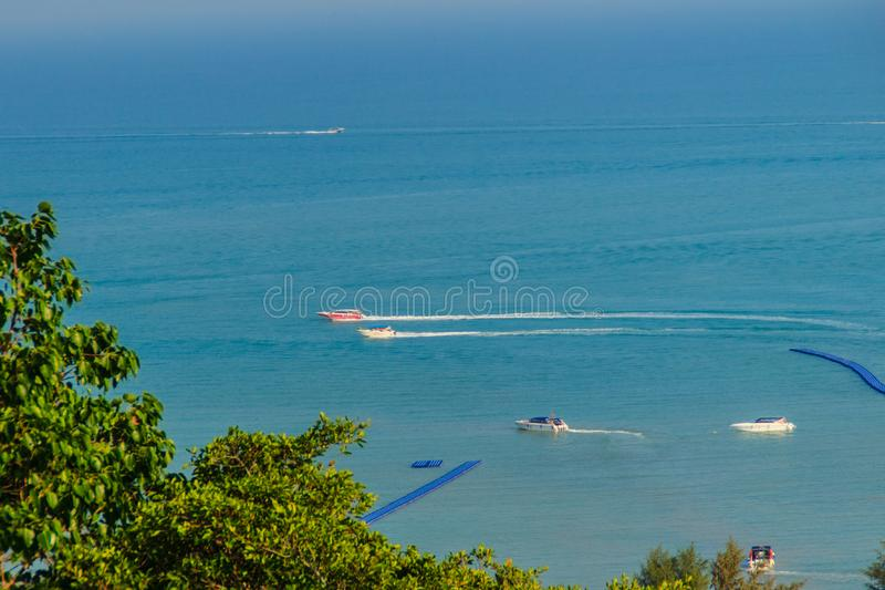 Beautiful blue sea view and tourist water activities such as boat racing, yacht cruising and jet skiing on Koh Sire beach. This pi. Cture took from top of Wat royalty free stock photography