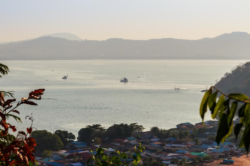 Beautiful blue sea view and tourist water activities such as boat racing, yacht cruising and jet skiing on Koh Sire beach. This pi. Cture took from top of Wat stock photo