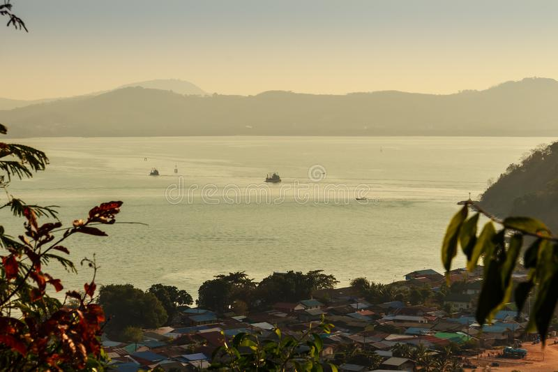 Beautiful blue sea view and tourist water activities such as boat racing, yacht cruising and jet skiing on Koh Sire beach. This pi. Cture took from top of Wat royalty free stock image
