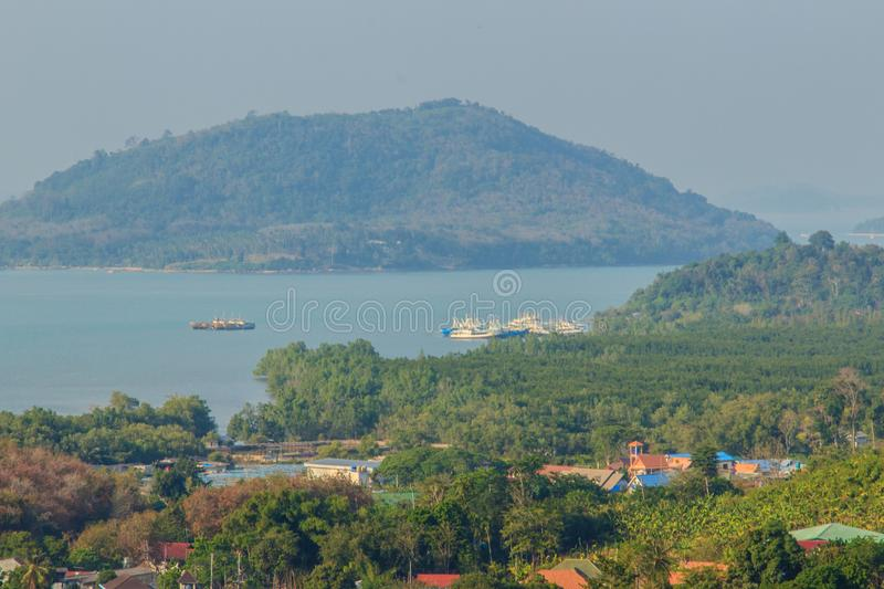 Beautiful blue sea view and tourist water activities such as boat racing, yacht cruising and jet skiing on Koh Sire beach. This pi. Cture took from top of Wat royalty free stock images