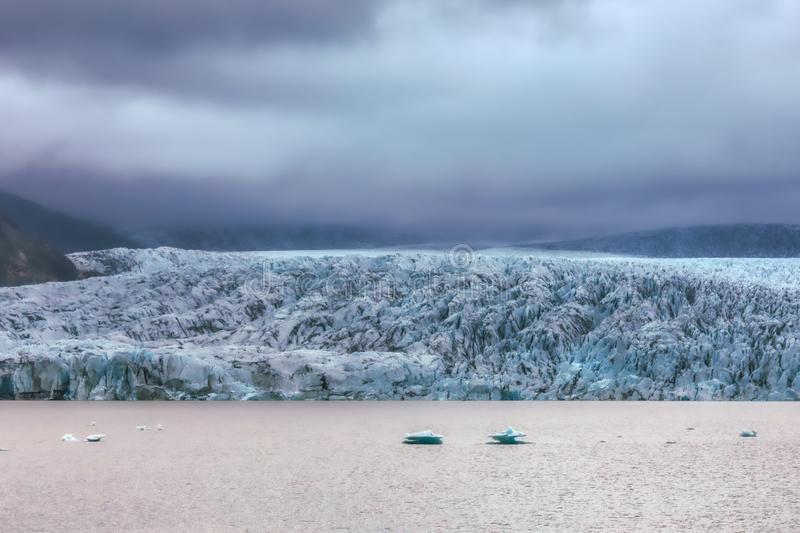 Beautiful blue shining glacier structure at the lagoon fjallsarlon on iceland stock photography