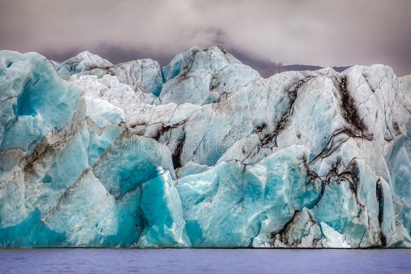 Beautiful blue shining glacier structure at the lagoon fjallsarlon on iceland. Summer royalty free stock photography