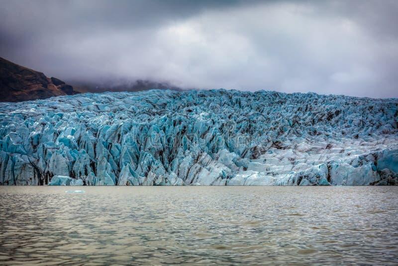 Beautiful blue shining glacier structure at the lagoon fjallsarlon on iceland royalty free stock photos