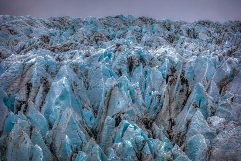 Beautiful blue shining glacier structure at the lagoon fjallsarlon on iceland stock photos