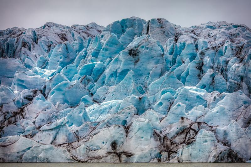 Beautiful blue shining glacier structure at the lagoon fjallsarlon on iceland. Summer stock images