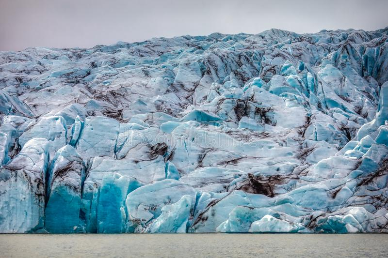 Beautiful blue shining glacier structure at the lagoon fjallsarlon on iceland royalty free stock image