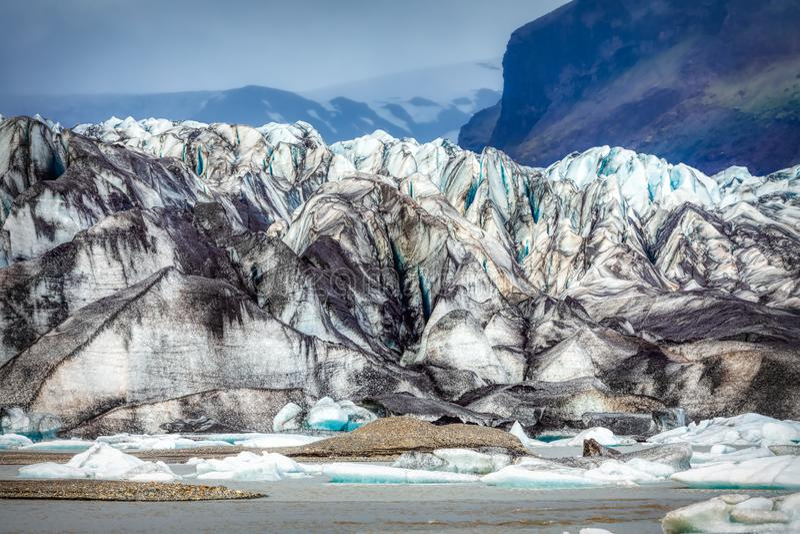 Beautiful blue shining glacier structure at the lagoon fjallsarlon on iceland. Summer royalty free stock image