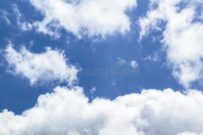 Beautiful blue sky background with clouds around. Beautiful blue sky background with white clouds around royalty free stock photos