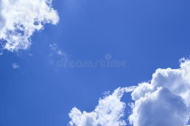 Beautiful blue sky background with clouds in corners. Beautiful blue sky background with two clouds in corners stock photo